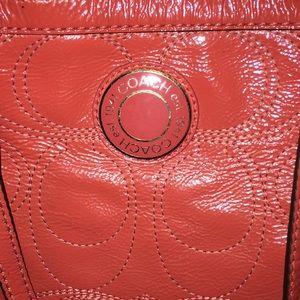 Coach C signature embroidered bag. Dark coral.
